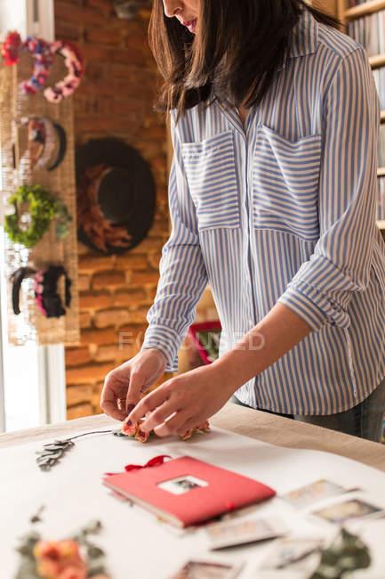 Woman creating ornament — Stock Photo