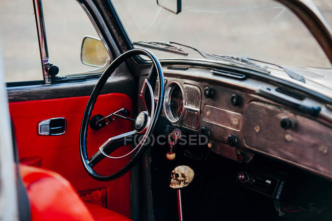 Driver seat with transmission lever skull handle — Stock Photo