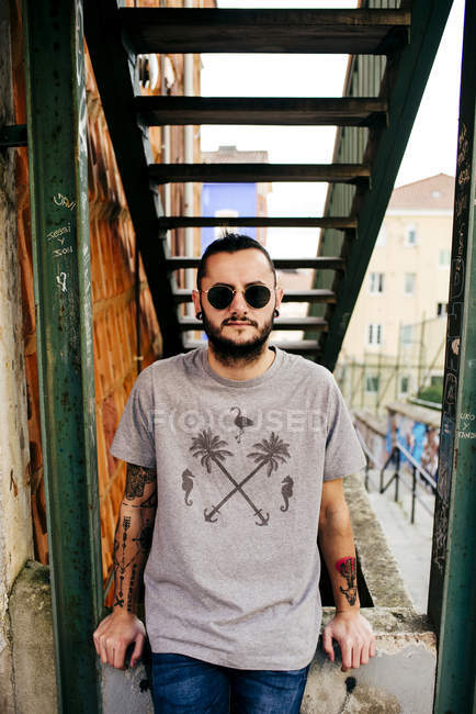 Stylish hipster with tattoos — Stock Photo