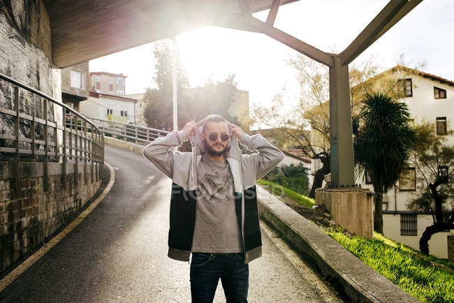 Young man on street — Stock Photo