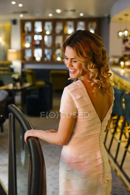 Smiling woman walking with wedding dress — Stock Photo
