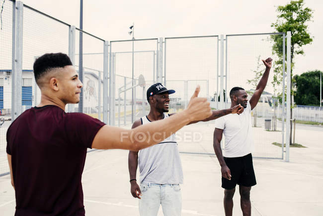Man on sports ground gesturing — Stock Photo