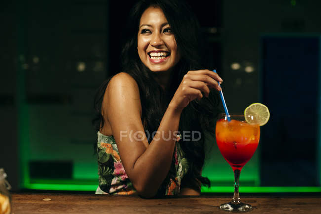 Woman with cocktail in bar — Stock Photo