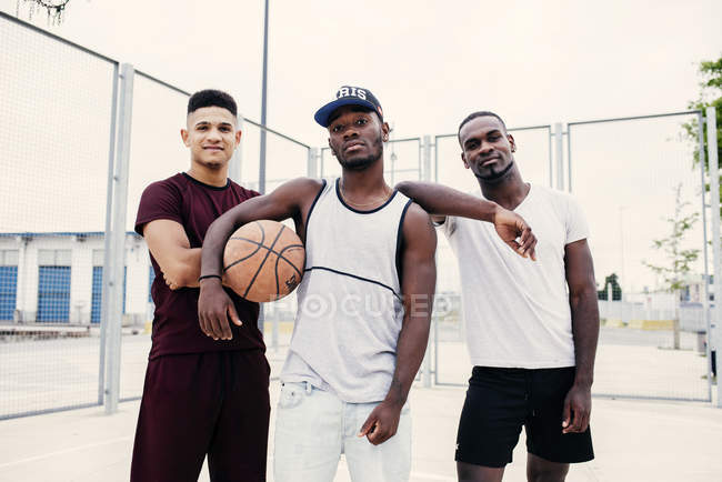 Confident men with basketball — Stock Photo