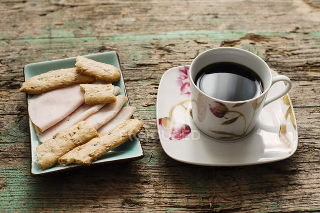 Tasse Kaffee und snacks — Stockfoto