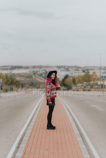 Girl posing at urban roadway — Stock Photo