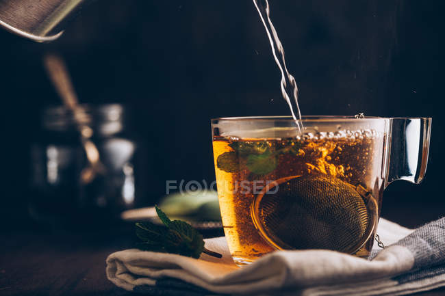 Pouring hot water into cup — Stock Photo