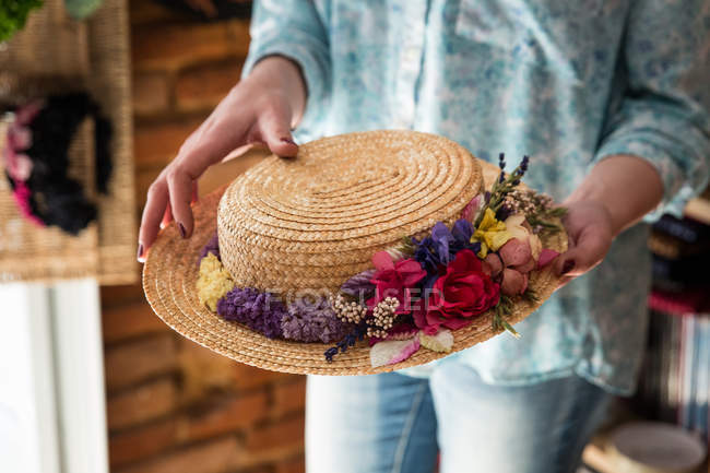 Crop woman holding decorated hat — Stock Photo