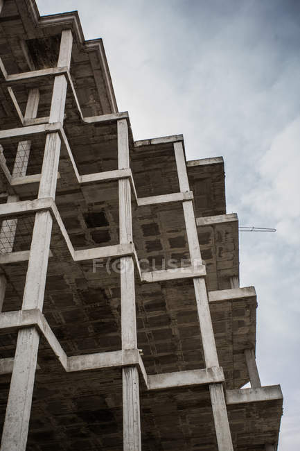 Bottom view of unfinished building with concrete facade — Stock Photo