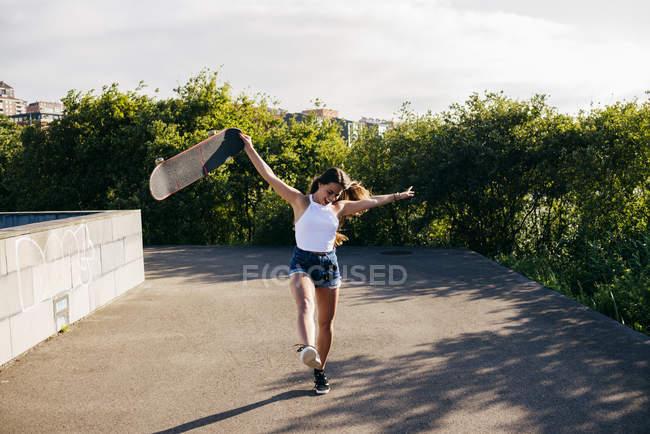 Trendy teenager on skate — Stock Photo