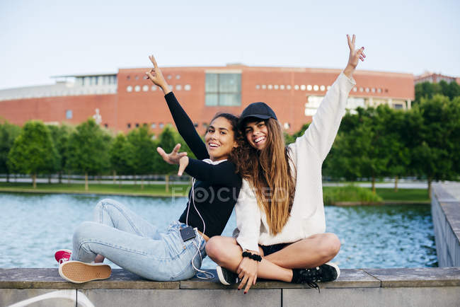 Cheerful trendy friends posing happily — Stock Photo