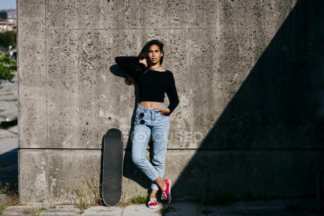 Stylish girl with skate — Stock Photo