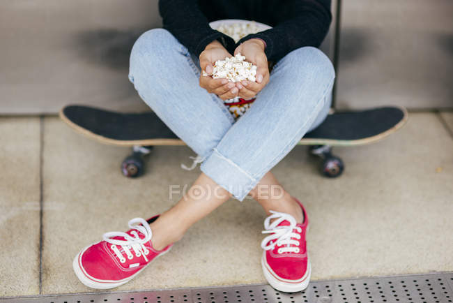Crop woman with pile of popcorn — Stock Photo