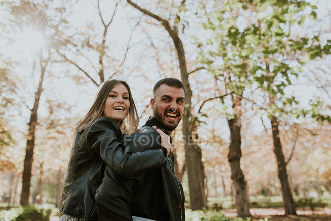 Portrait of expressive couple smiling and having good time in park — Stock Photo