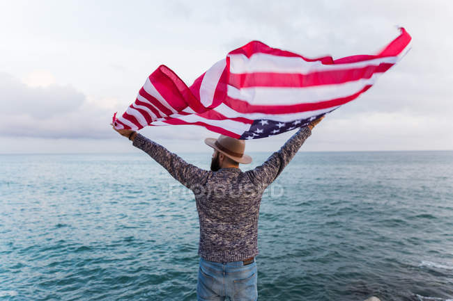 Man with American flag — Stock Photo