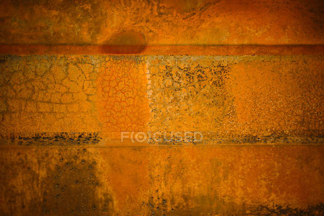 Burn and rusty piece of metal — Stock Photo