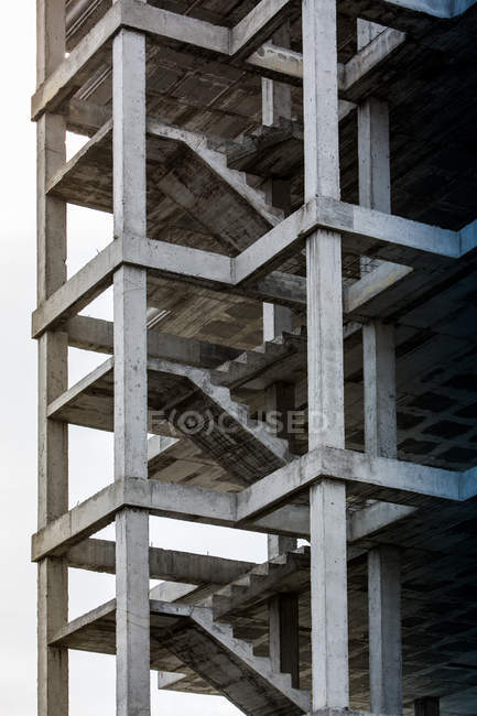 Exterior view of unfinished building with concrete staircases — Stock Photo