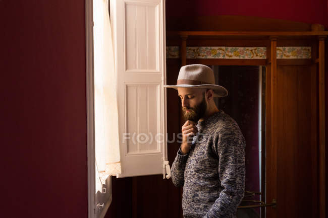 Male standing near window — Stock Photo