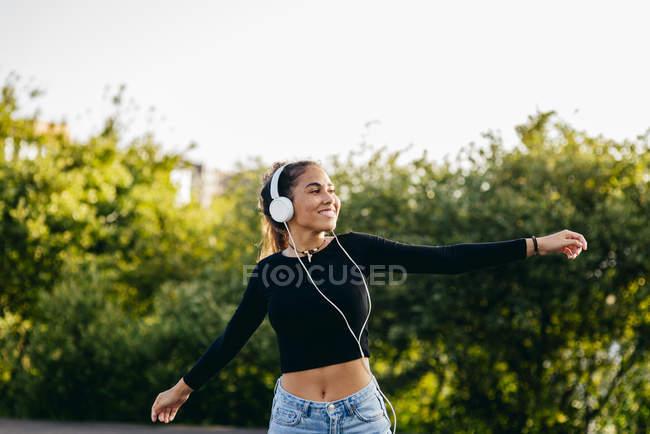Cheerful happy teen in headphones — Stock Photo