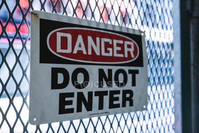 Danger Sign on fence — Stock Photo
