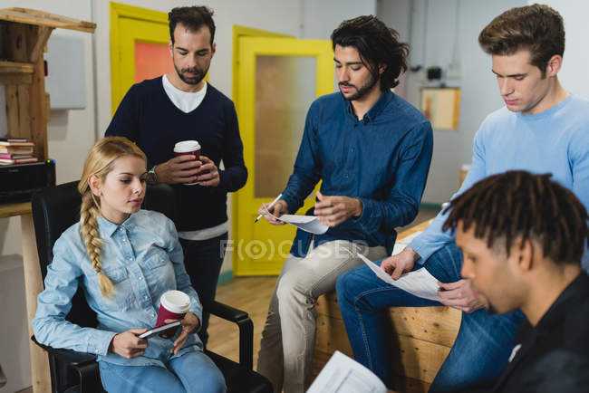High angle view of multi-ethnic business people communicating while meeting — Stock Photo