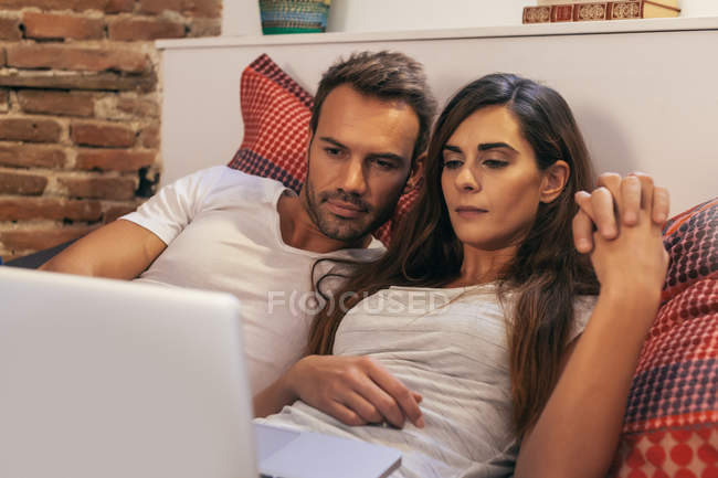 Couple in Bed Watching a Movie — Stock Photo