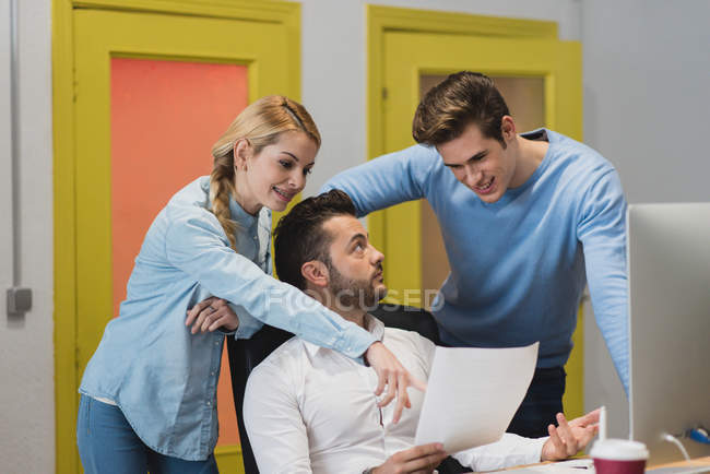 Portrait of business people discussing document papers in office — Stock Photo