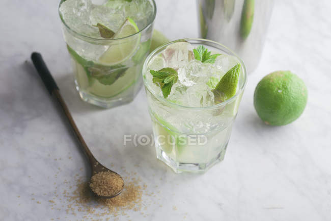 Glasses of mojito with rum — Stock Photo
