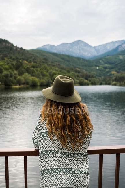 Back view of hipster on landscape — Stock Photo