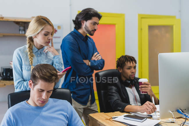 Portrait of  multi-ethnic business people at workplace — Stock Photo