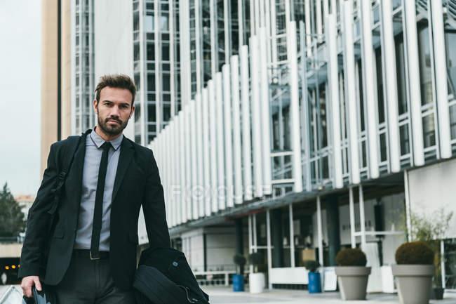 Elegant Businessman Walking with Motorbike Helmet — Stock Photo