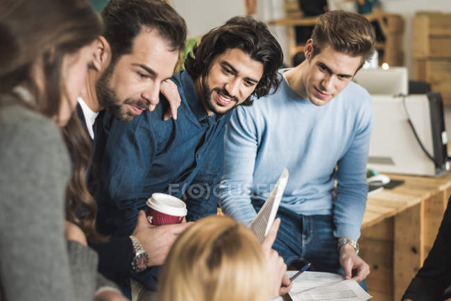 Multi-ethnic business people communicating at meeting in office — Stock Photo