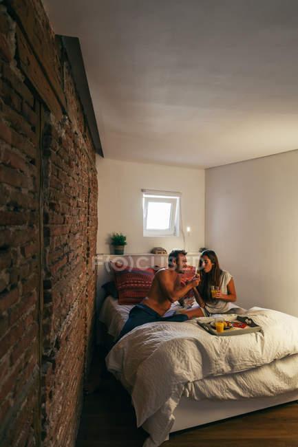 Couple Having Breakfast on Bed — Stock Photo
