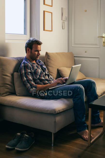 Young Man Using Laptop — Stock Photo