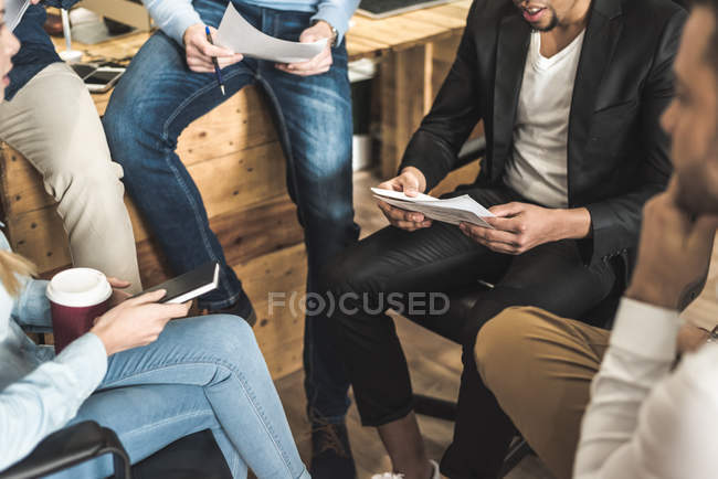 Midsection of colleagues talking at meeting in office — Stock Photo
