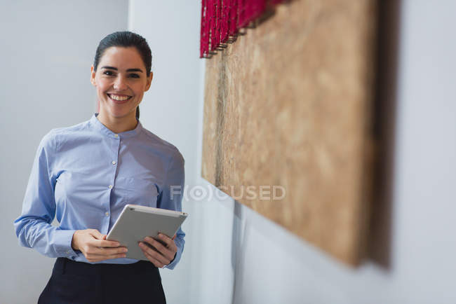 Portrait of smiling woman posing with the tablet — Stock Photo