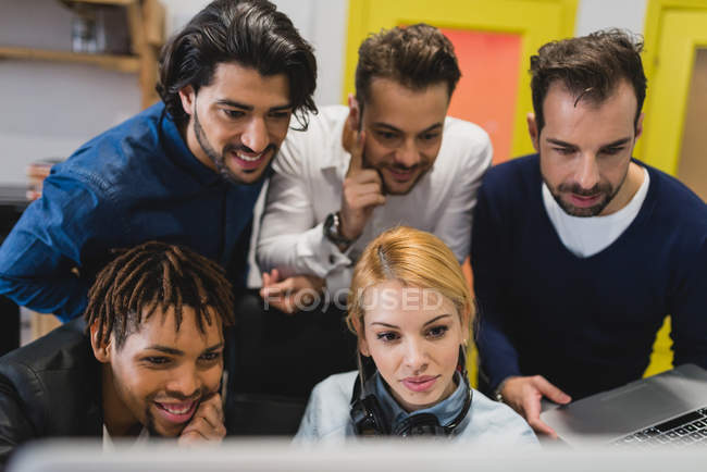 Top view of colleagues looking at display in office — Stock Photo