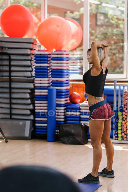 Athletic woman stretching in Gym — Stock Photo