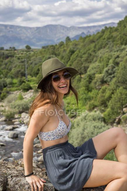 Stylish young woman on nature — Stock Photo