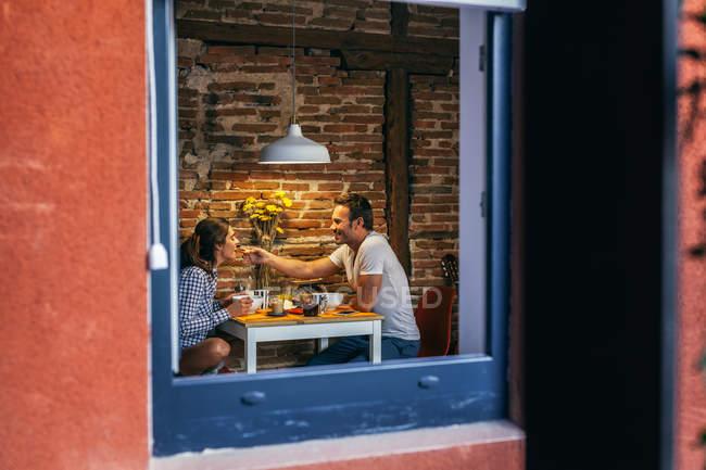 Young Couple Having Breakfast — Stock Photo