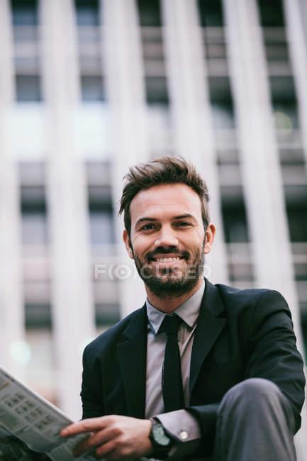 Businessman Holding a Newspaper — Stock Photo