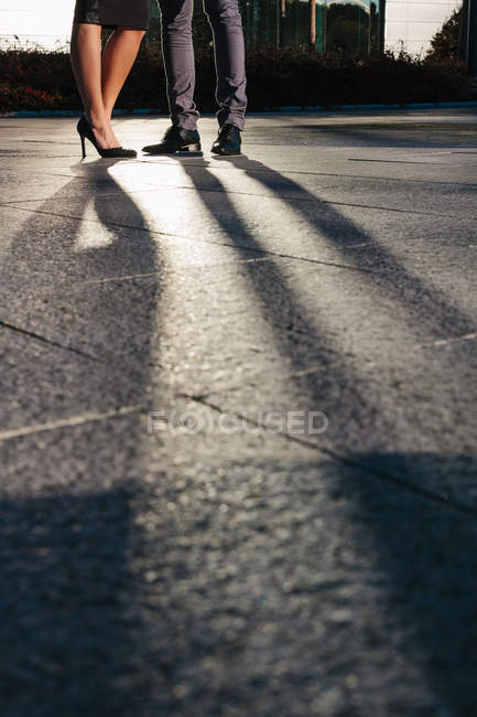 Large Shadow of  Business Couple standing at Street — Stock Photo