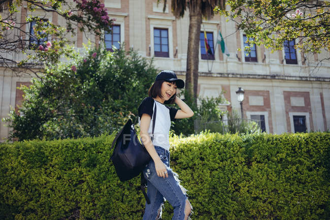 Trendy woman posing in cap — Stock Photo