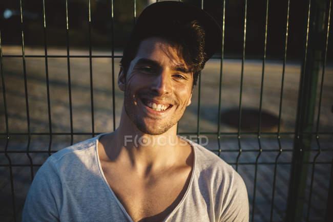 Smiling man in sunbeams — Stock Photo
