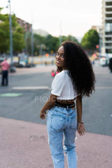 Woman walking on street — Stock Photo