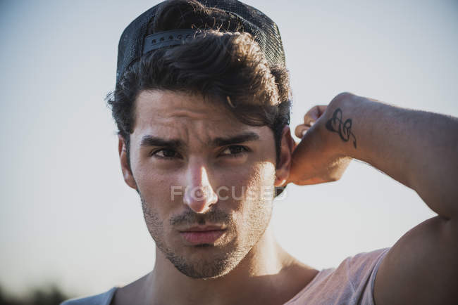 Young stylish man in cap — Stock Photo