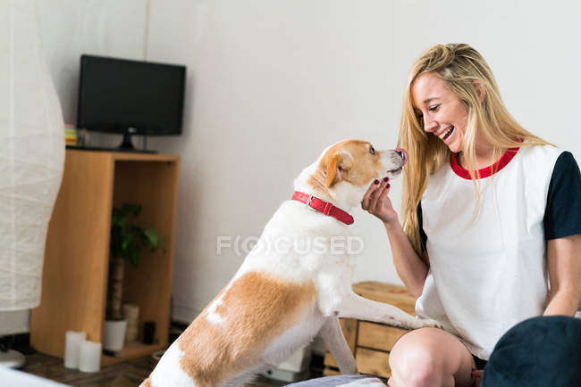 Woman playing with her dog — Stock Photo