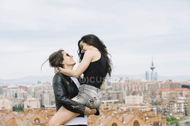 Side view of playful lesbian couple — Stock Photo