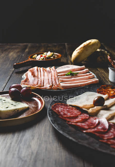 Plates with tradional spanish appetizers — Stock Photo