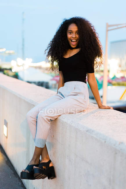 Pretty woman sitting on street — Stock Photo
